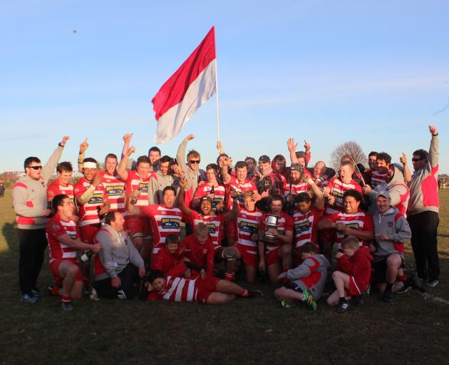 The Clutha Rugby team celebrates its 60-12 win against Crescent in the Southern Region final on...