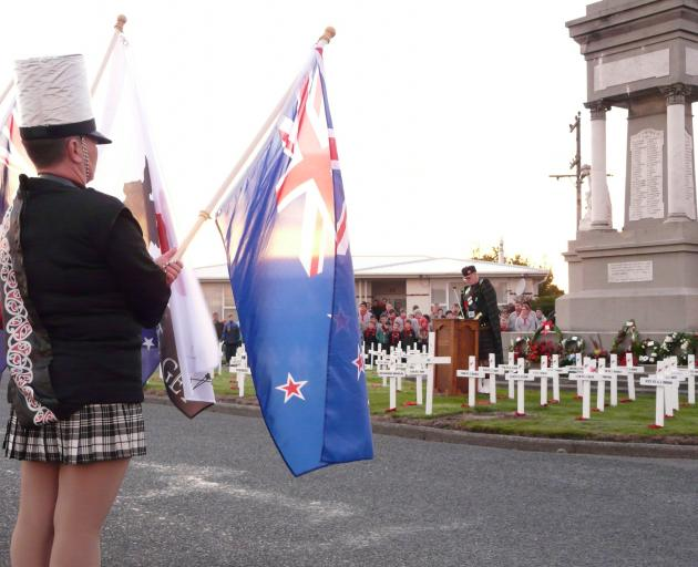 Rev Alex McLaughlin leads the dawn Anzac service at Balclutha Cenotaph yesterday. PHOTO: RICHARD...