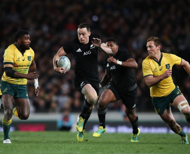 Ben Smith runs the ball for the All Blacks against Australia. Photo: Getty Images