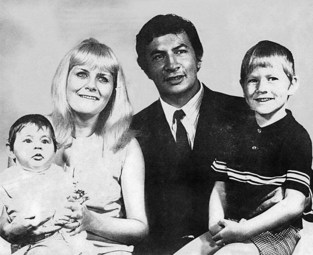 Shayne Carter (right) with his parents and sister in a family portrait photograph taken in 1970.