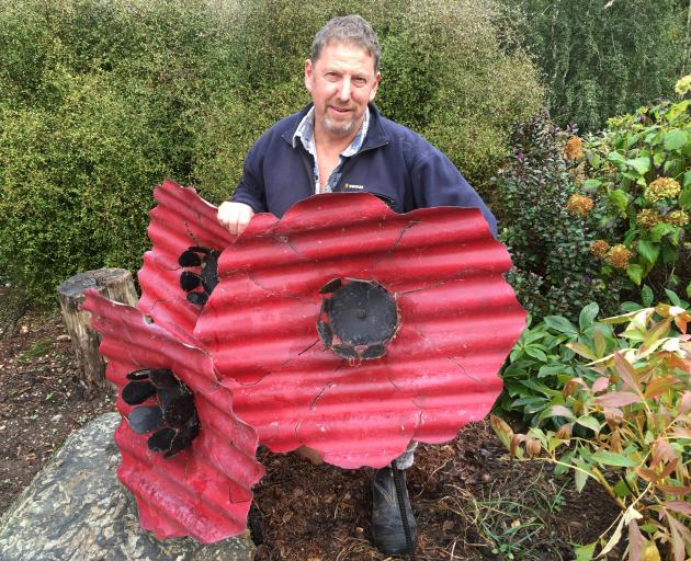 Poppies and a lone soldier, created by Richard Simpson, will be returned to one of his roadside paddocks at Chatto Creek this Anzac Day. Photo: Supplied