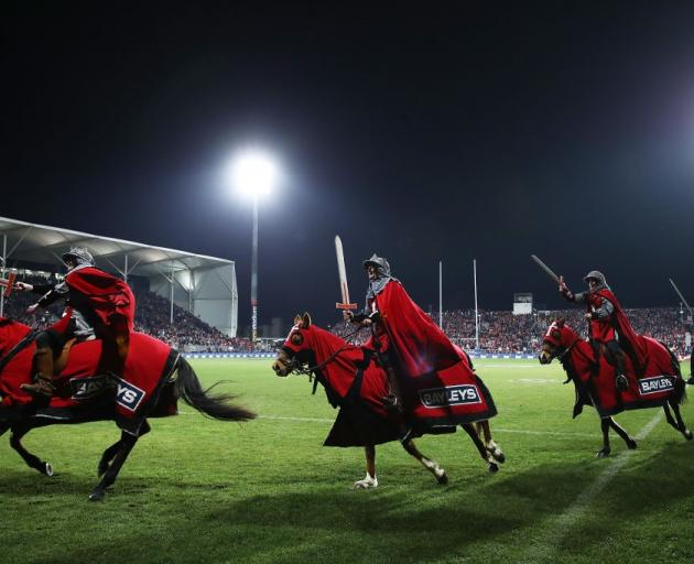 The sword-wielding knights riding horses will likely not appear at the next Crusaders game. Photo...