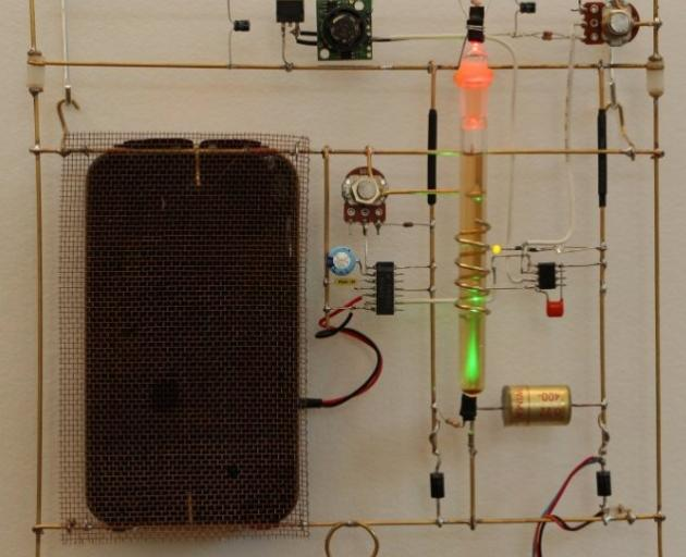 Dark perfume with integrated circuits by Raewyn Turner and Brian Harris