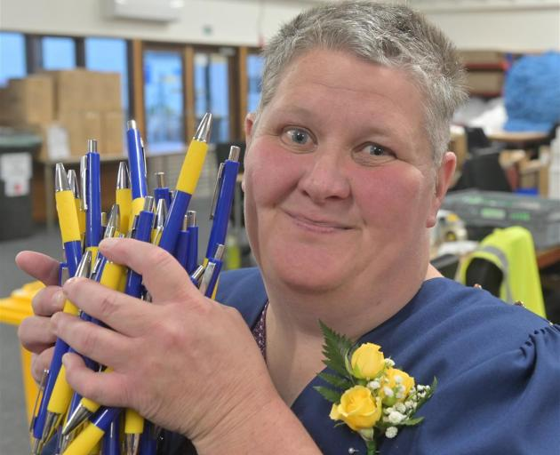 After earlier assembling plenty of pens, Cargill Enterprises worker Deborah Rielly finished yesterday on a high by graduating from a literacy and numeracy course. Photo: Linda Robertson