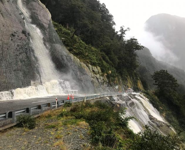 Heavy rains have caused a washout in the Diana Falls area of State Highway 6, the Haast Pass. Photos: NZTA