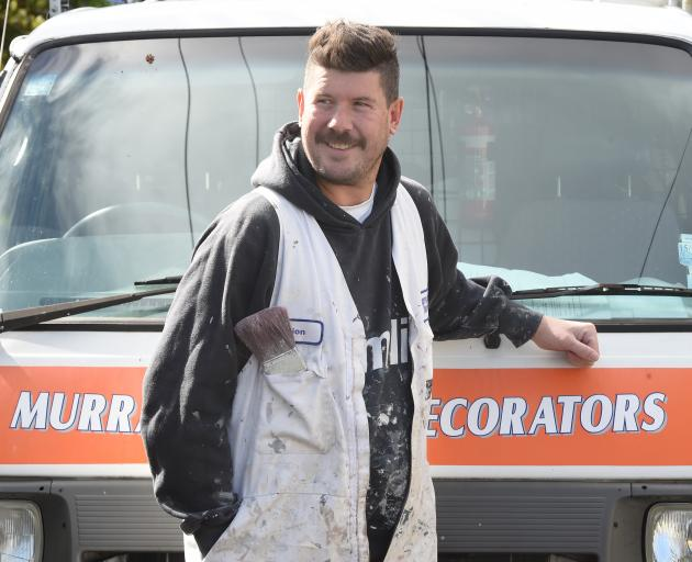 Retiring Green Island Cricket Club veteran Dion Lobb, pictured with his painting and decorating...