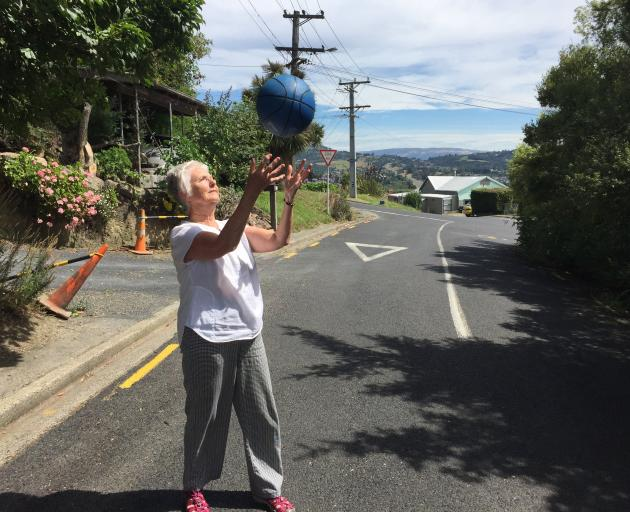 Green Island resident Donna Peacock plays in the street. Photo: Supplied