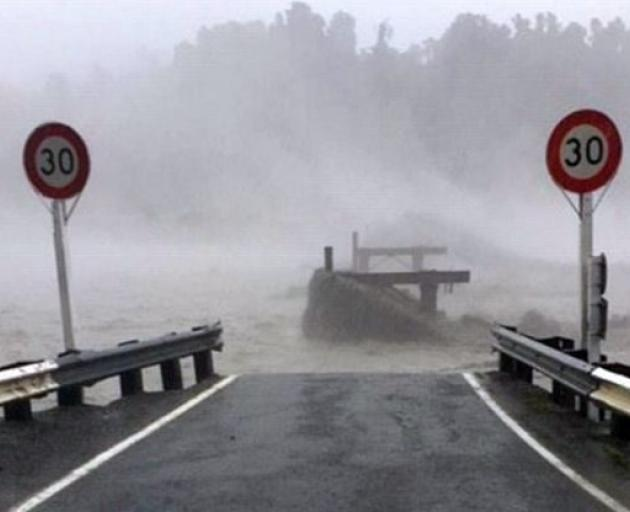 The Waiho Bridge has been taken out by the weather hitting Westland. Photo: Civil Defence West Coast