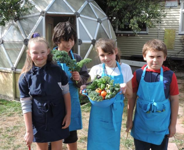 Proudly displaying produce harvested from the school garden for their Garden to Table session are (from left) Chloe Freeman (9), Tano Parker (9), Tayla Cornish (9) and Jacob Balloch (9). Photos: Charmian Smith