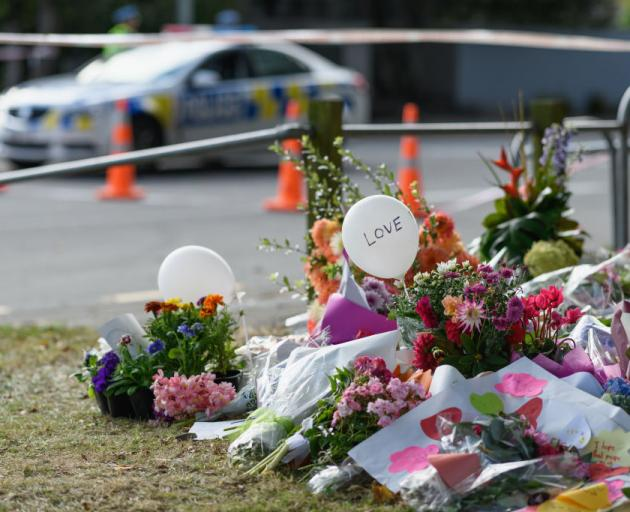 Flowers and condolences are seen in front of Al Noor mosque in Christchurch. Photo: Getty Images