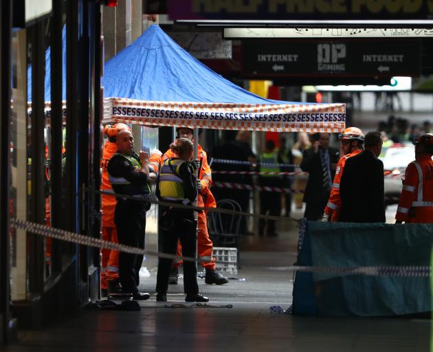 Police and scene examination personnel at the site of a homicide in Melbourne's CBD. Photo: Getty...