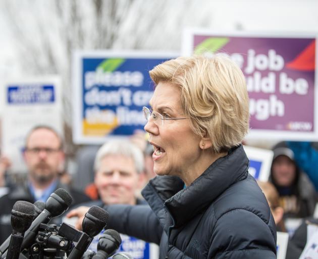 Democratic Presidential hopeful Elizabeth Warren speaks to media after joining striking Stop &...