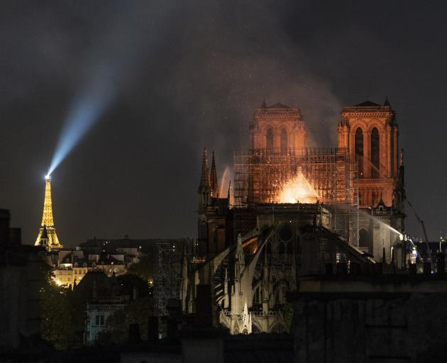 Flames and smoke rise from the Notre Dame Cathedral in Paris last week. Photo: Getty Images