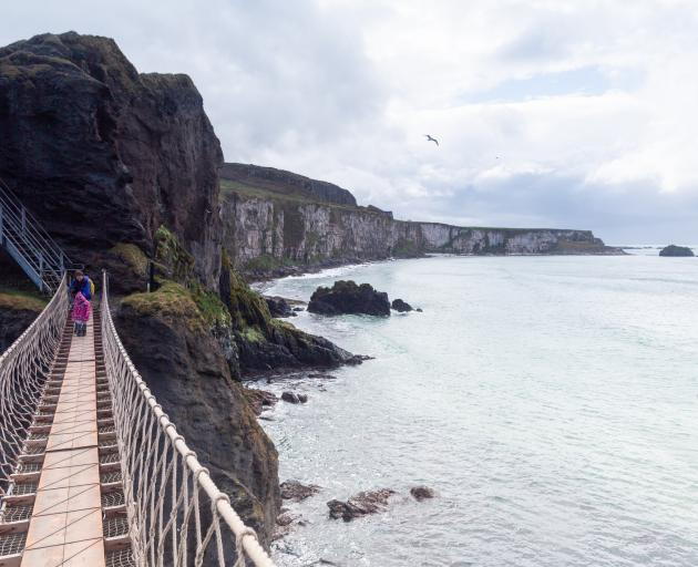Carrick-a-Rede rope bridge connects the cliffs to a small island.