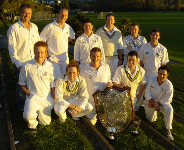 A younger Lobb (back row, third from the left) celebrates with his Green Island team-mates after...