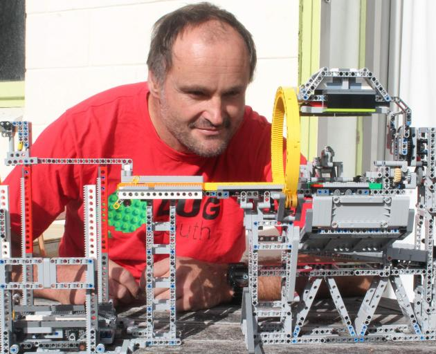 Chris Knight has been collecting Lego bricks since last year and has more than 10,000 in his...