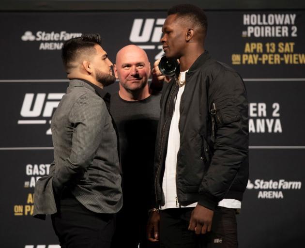 Israel Adesanya (right) and Kelvin Gastelum face off alongside UFC president Dana White ahead of...