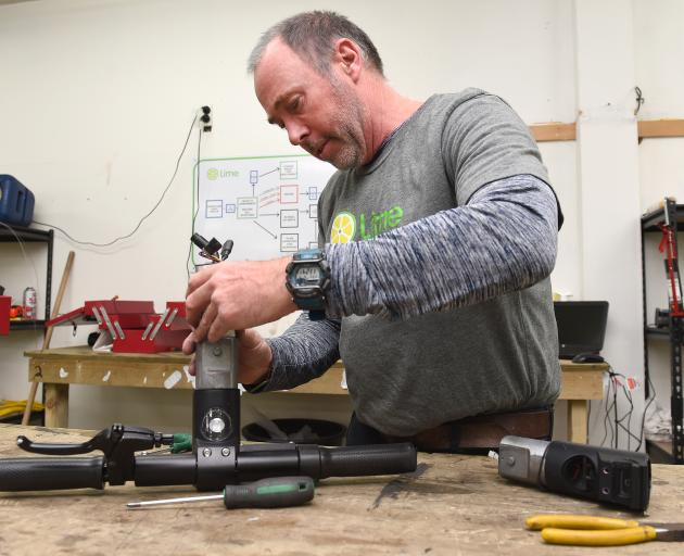 Every day Lime operations shift leader Paul Tyler and his team of mechanics repair and refurbish...