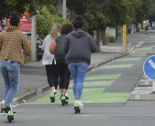 A small group of Lime scooter riders make their way down the Cumberland St cycleway. Photo: Gerard O'Brien