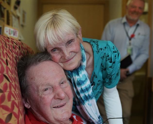 World War 2 veteran and dementia patient Neil Harper (97) and  wife Laurel, who he remembers thanks to her perfume,  watched by RSA support adviser Niall Shepherd, who found new bottles of the scent when it stopped being sold. Photo: Christine O'Connor