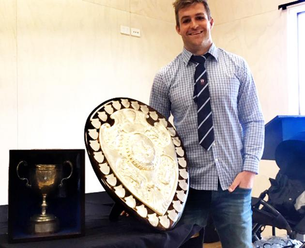 Blues and Otago fullback Michael Collins with the Ranfurly Shield and White Horse Cup after...
