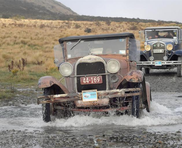 John Wilson, of Christchurch, splashes his 1929 Ford A through a creek on the Mavora Lakes road. One hundred and fifty cars journeyed from Te Anau to Walter Peak station yesterday during the 14th National Model A rally. Photo: Stephen Jaquiery