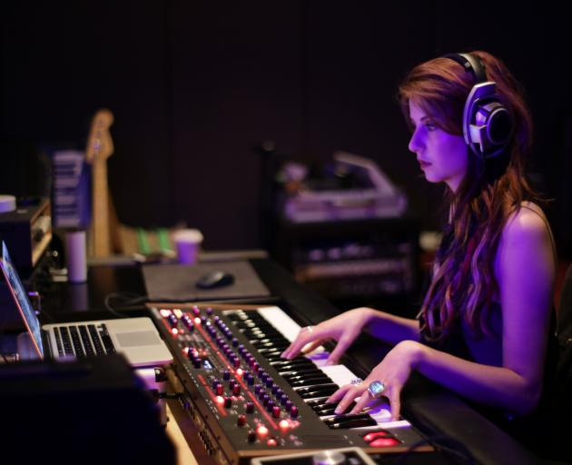 Molly Devine works on her new music being recorded in Wellington. Photo: Nik Brinkman