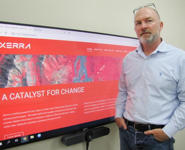 Xerra Earth Observation Institute Ltd chief executive Steve Cotter stands beside the rebranded...