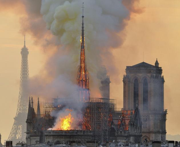 Flames and smoke rise from the blaze at Notre Dame Cathedral, with another famour landmark, the...
