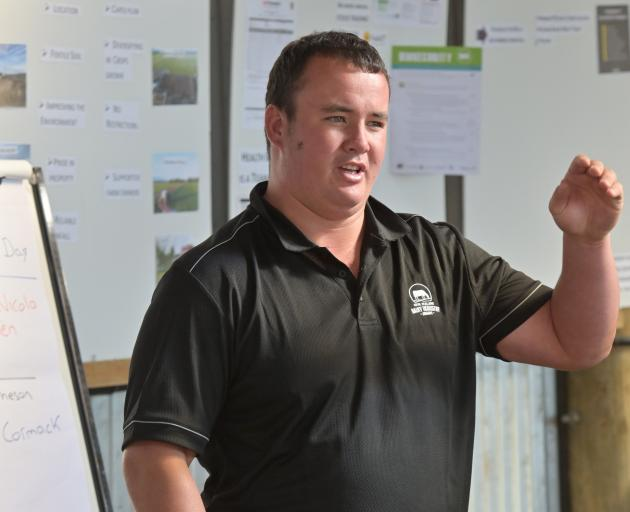 Otago Southland dairy farm manager of the year James Matheson speaks at the New Zealand Dairy Industry Awards Otago Southland field day at Bull Creek Rd, Outram last Wednesday. Photo: Linda Robertson