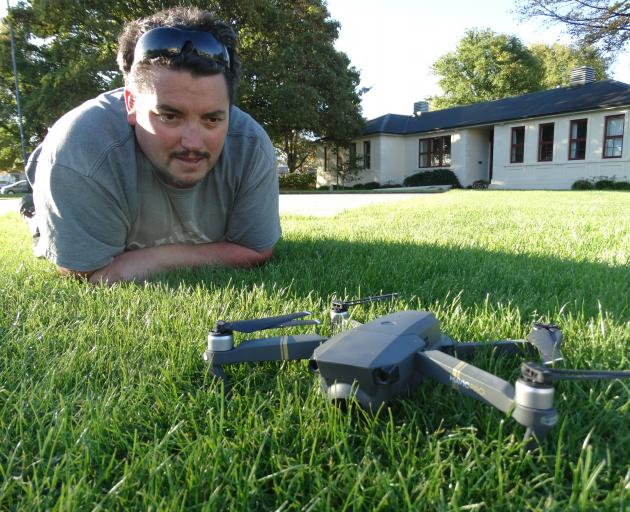 Oamaru's Damien McNamara, of Altitude Surveying, with his drone at Takaro Park near Oamaru Hospital. He is unable to fly his drone within a 4km radius of the hospital unless he adheres to Civil Aviation Authority rules. Photo: Daniel Birchfield