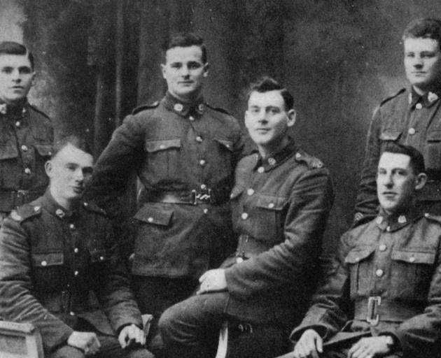 Southland and Otago men in Cologne, Germany. Standing (from left): Lance-corporal D. Stark (Waikoikoi), Private W. Scarlett (Otamita), Private A. McIntyre (Benio). Sitting: Private J. McIntyre (Maitland), Private A. Johnston (Waikaka Valley), Corporal W.