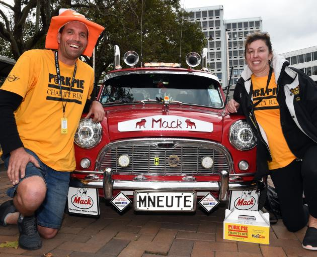 Chris Westlake and partner Tracey Bigland-Frost, of Dargaville, next to their 1965 Mini which has been made to look like a Mack truck. Photo: Gregor Richardson