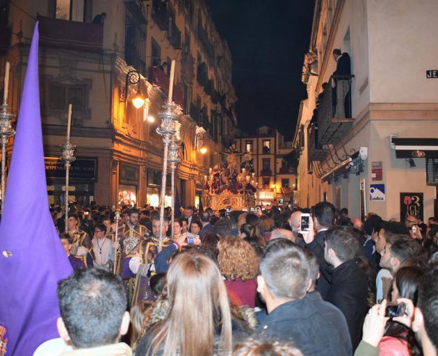 Processions go through night.