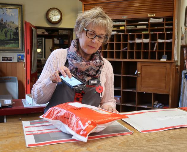 It was another busy morning for Arrowtown Post Office postal assistant Joan Sutton yesterday....