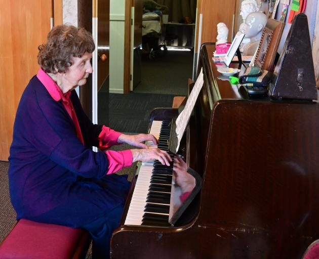 Marie Millar plays Strangers In The Night on the piano in her room at Radius Fulton.PHOTO: LINDA...