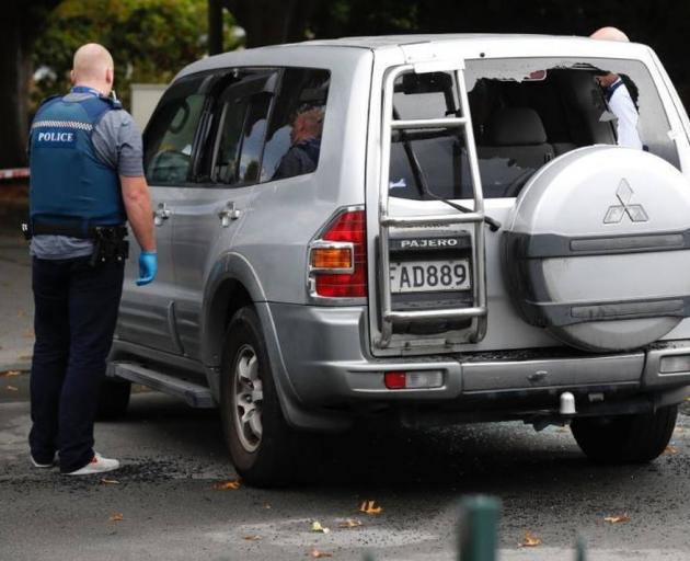 The driver's window, rear driver's side window and rear window are all smashed out. Photo: NZME