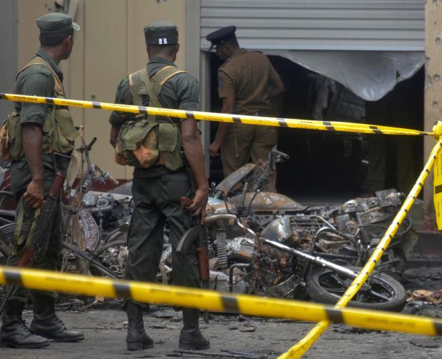 Sri Lankan military stand guard near the explosion site at a church in Batticaloa. Photo: Reuters (NO ARCHIVE)