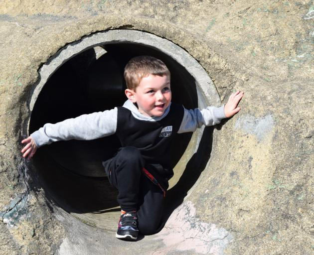 Blake Hunt (5) plays on the Saddle Hill tunnels play equipment at Marlow Park in St Kilda on...