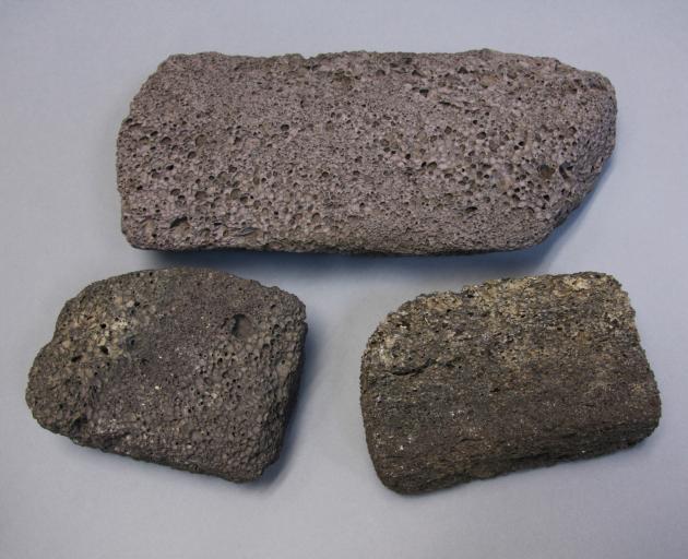 The Tautuku scoria block (at top), a similar block from Rakiura (Stewart Island), bottom left,...