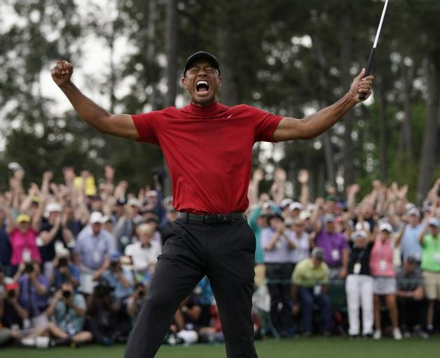 An ecstatic Tiger Woods celebrates his win at Augusta. Photo: AP