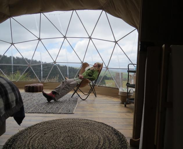 Relaxing in Big Ben, my glamping tent accommodation, complete with windows. Photos: Maureen Howard