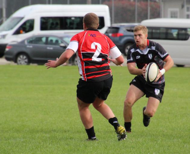 Edendale's Jeroe Fodie looks to go past Midlands hooker Lachie Wood in a match in Edendale...