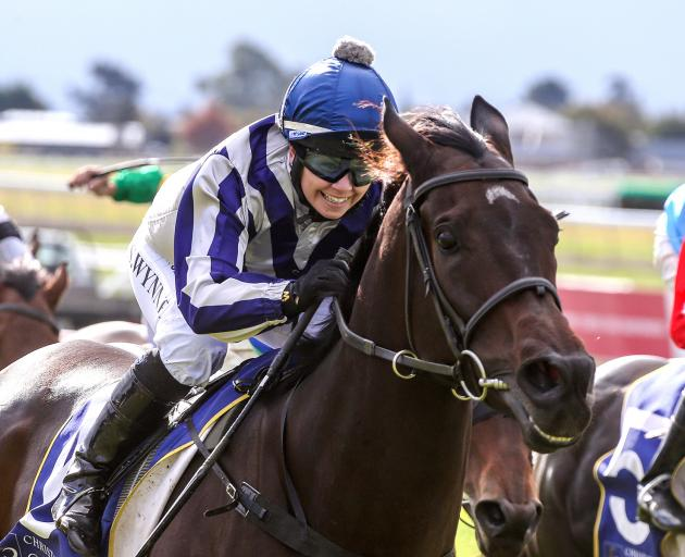 Samantha Wynne knows she and Who Dares Wins have the Easter Cup in the bag at Riccarton Park on...