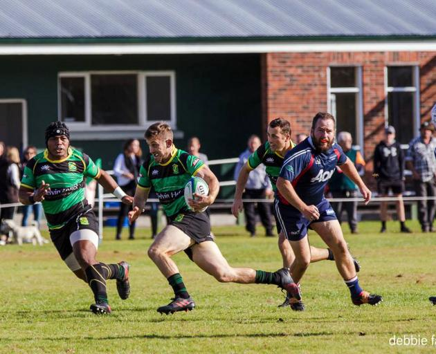 Marist's Scott Eade looks to move the ball during the side's win over Woodlands in Invercargill...