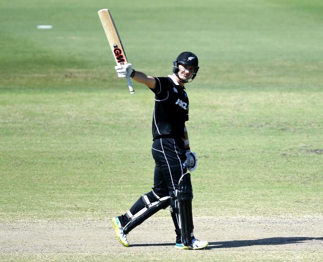 New Zealand XI batsman Will Young celebrates scoring a century during the World Cup warm-up match...