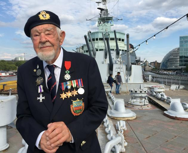 D-Day veteran Richard Llewellyn poses for a photograph on HMS Belfast, on the River Thames in...