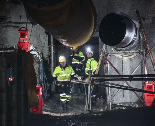 Pike River mine deputy Kirk Neilson (left), site senior executive Dinghy Pattinson and geotechnical engineer Chris Lee pass through the first of two airlock doors at the entrance to the Pike River mine. Photos: Pike River Recovery Agency