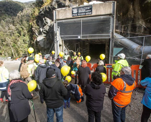 Balloons representing the 29 men who died in the Pike River mine explosion are released outside the pit entrance on Tuesday. Photo: Pike River Recovery Agency