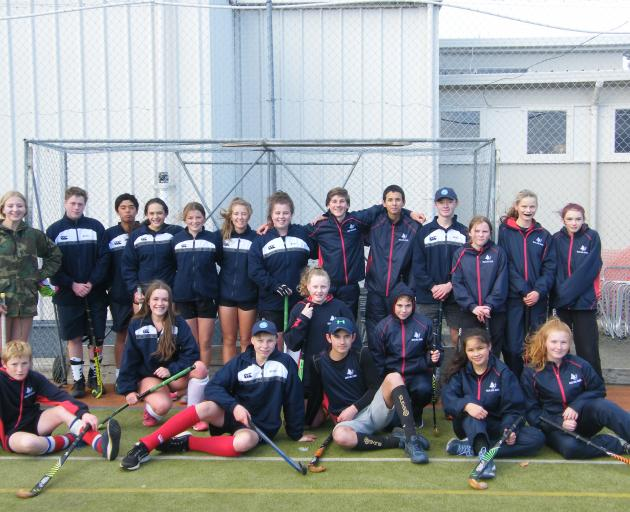 Maniototo (left) and Waiau School hockey teams assemble following yesterday's action. PHOTOS:...